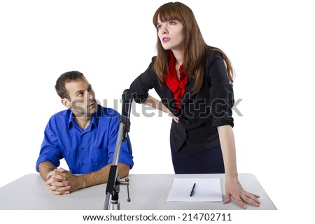 female lawyer representing male client in a court hearing - stock photo