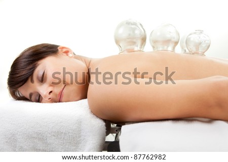 Female laying on chest with cupping treatment on back - stock photo