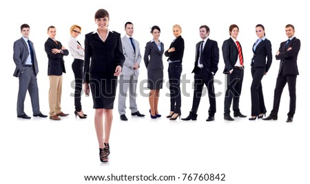 Female leader walking in front with her team behind - stock photo