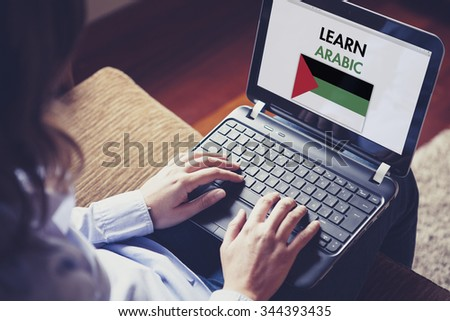 Female learning arabic at home with a laptop computer at home. - stock photo