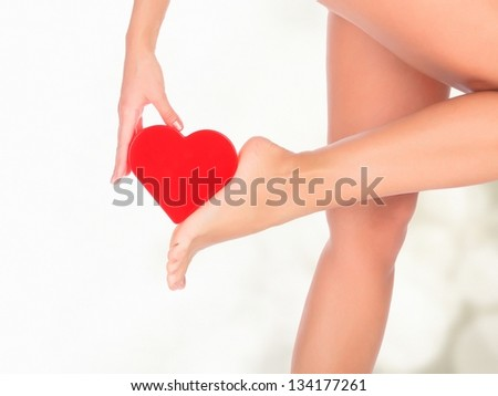Female legs against a pastel background with blurred lights - stock photo