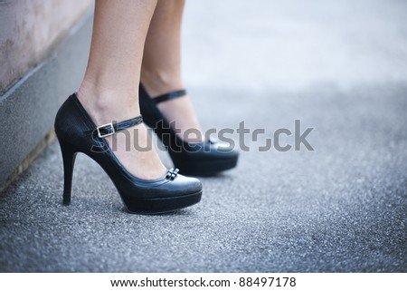 Female legs and high heels shoes