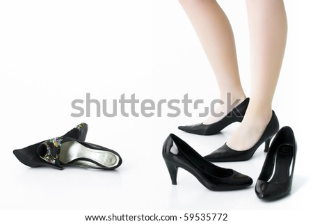 female legs and shoes on white background