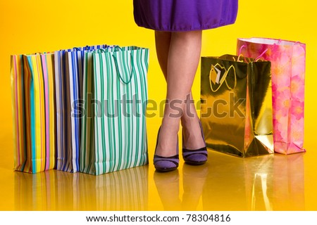 Female legs and shopping bags - stock photo