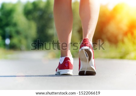Female legs during outdoor workout at sunrise. Concept. - stock photo