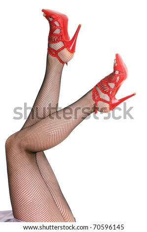 female legs in black pantyhose isolated on white background