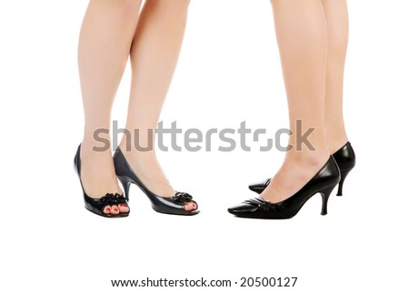 female legs in black shoes isolated on white