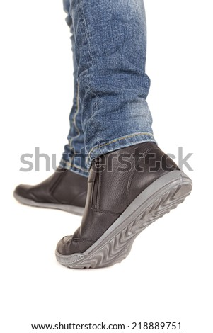 female legs in boots marching - stock photo