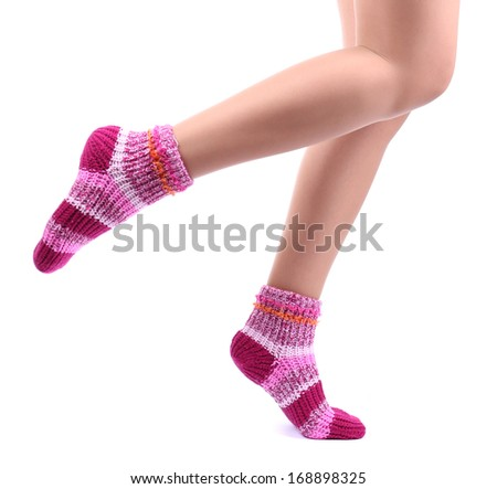 Female legs in colorful socks, isolated on white - stock photo