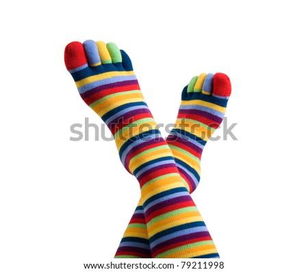 female legs in colorful striped socks - stock photo