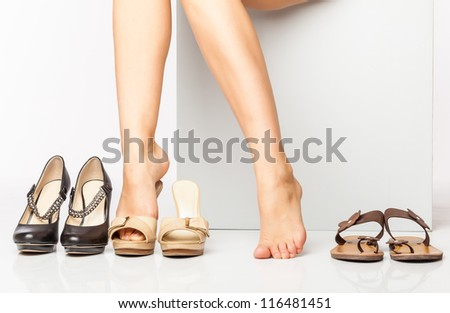 female legs in fashion shoes. isolated on a white background