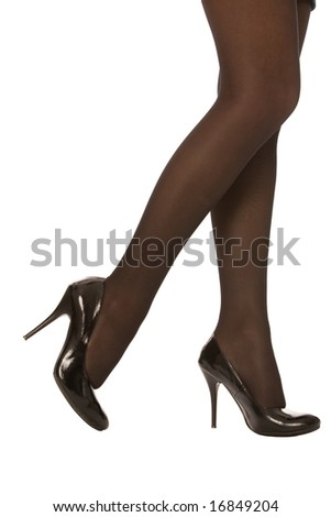female legs in high heel shoe isolated on a white background - stock photo