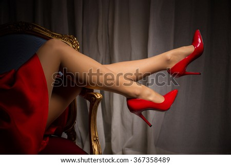 Female legs in red high heels  - stock photo