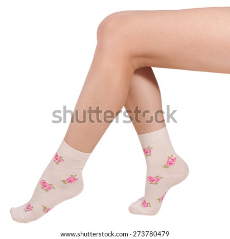 Female legs in socks. Isolated on a white background - stock photo