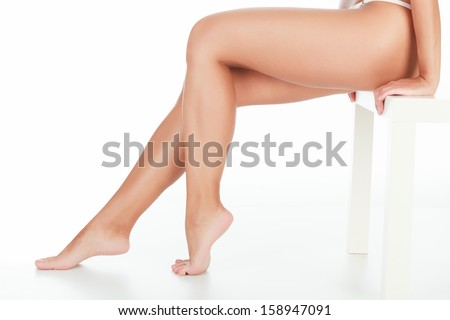 Female legs on white background, copyspace - stock photo