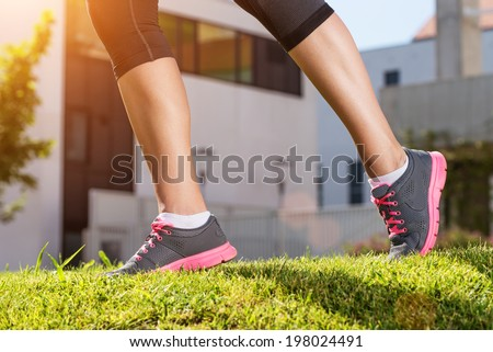 Female legs running, the outdoors, detail photo