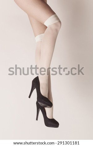 Female legs sexy position while wearing parisian stockings and heels