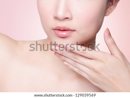 Female lips closeup. Beautiful smile of young fresh woman.  Isolated over pink background. easy for you change color of lipstick for your product, asian model - stock photo
