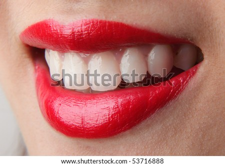 Female lips with red lip gloss