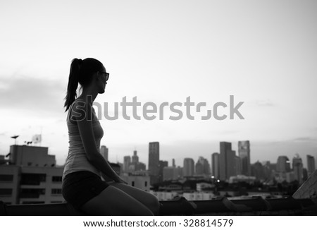Female looking at the city from afar.  - stock photo