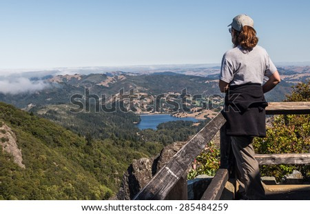 Female looking at the Marin Lakes from top of Mt. Tamalpais in Marin County