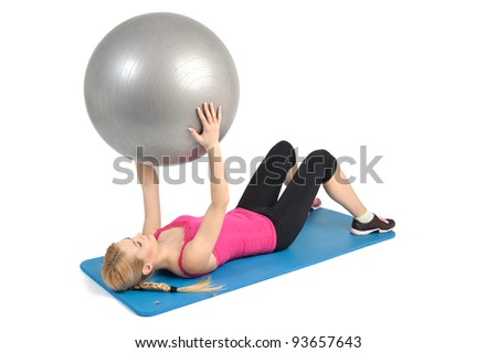 Female lying abs crunching exercise with fitness ball. position 1 of 2. - stock photo