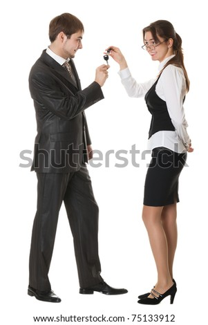 female manager gives a man a car key isolated on white - stock photo