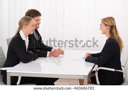 Female Manager Interviewing Young Confident Applicant In Office