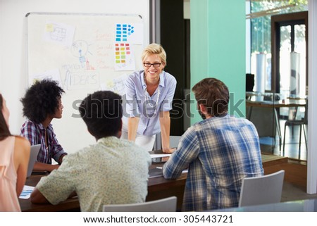 Female Manager Leading Brainstorming Meeting In Office