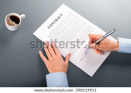 Female manager signing contract. Woman puts signature on contract. Morning at our office. I'm satisfied with the conditions. - stock photo