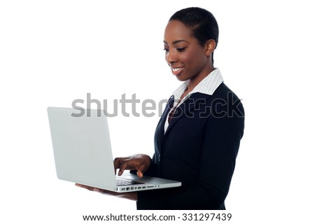 Female manager working on laptop