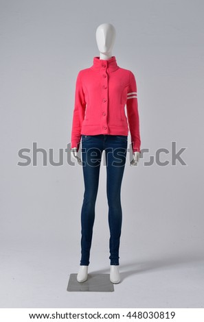 female mannequin in red dressed in jeans with hat â??gray background, - stock photo