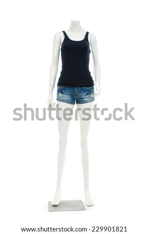 female mannequin in trousers, jeans shorts and black shirt - stock photo