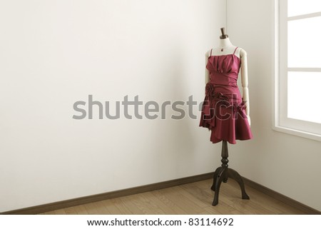 Female mannequin in white room. - stock photo