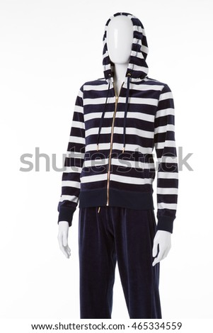 Female mannequin in zipper hoodie. Striped top and navy pants. Sports clothing in local store. New brand of activewear.