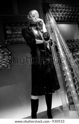 female mannequin on a window store display - stock photo