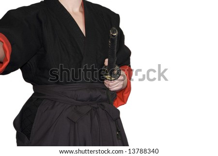 Female martial art fighter - performance in a traditional outfit - stock photo