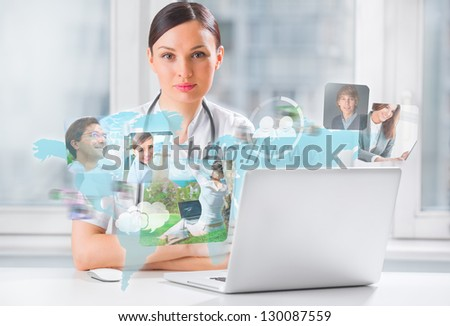 Female medical doctor surfing on web with modern laptop - stock photo