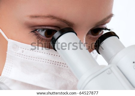 Female medical doctor using microscope in a laboratory on white background - stock photo
