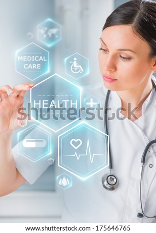 Female medical doctor working with healthcare icons. Modern medical technologies concept - stock photo