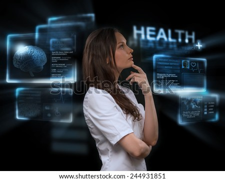 Female medical doctor working with virtual interface. Modern medical technologies concept