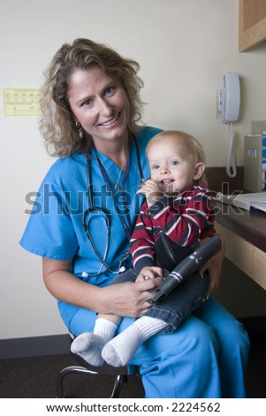 female medical professional in office with child - stock photo