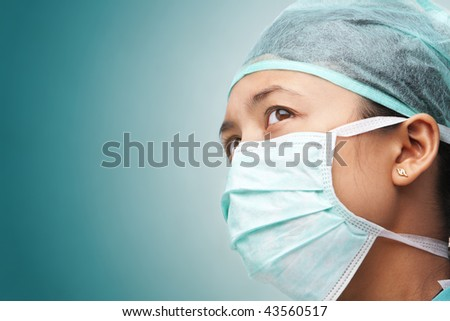 Female medical worker looking away to empty space - stock photo