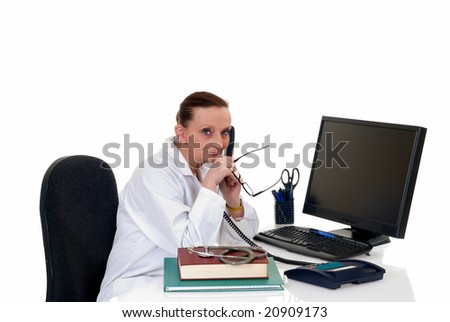 Female middle aged doctor making phone call with patient, white background,  studio shot. - stock photo