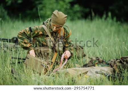female military doctor to help the wounded soldier - stock photo