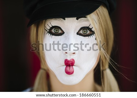 Female Mime on red background, selective focus - stock photo