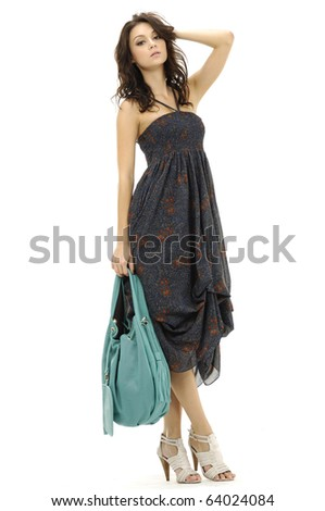 Female mode in evening at fashion show in studio - stock photo