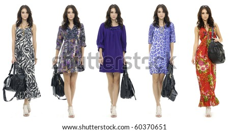 Female mode in evening holding handbag at fashion show in studio - stock photo