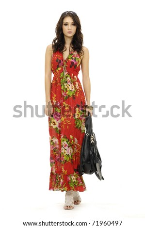 Female mode in evening with handbag at fashion show in studio - stock photo