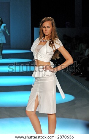 Female model at a fashion show - stock photo